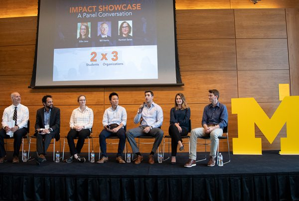 Students on stage at business event