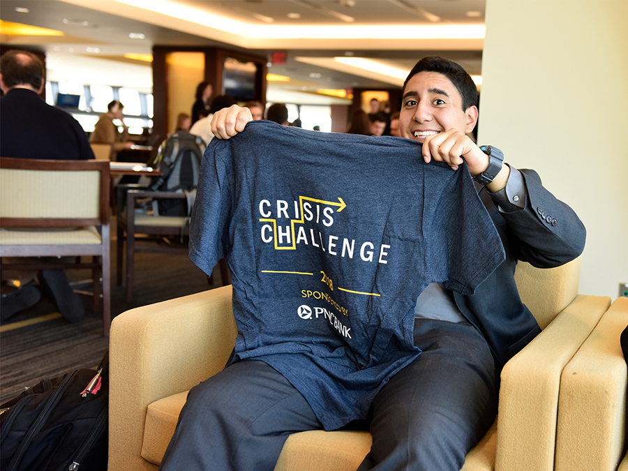 Max Garcia holds up a t-shirt