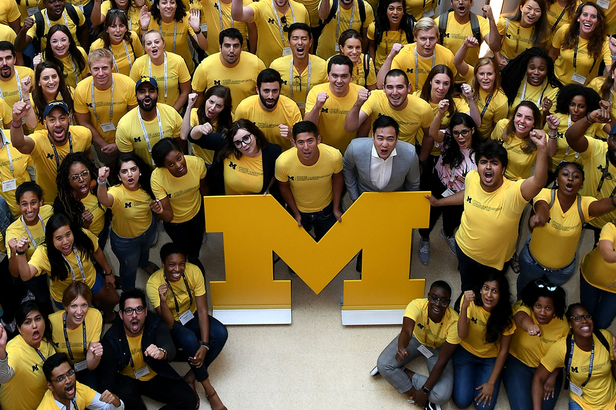 Michigan students around block M